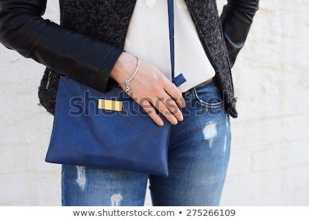 lovely woman with small handbag stock photo © dolgachov