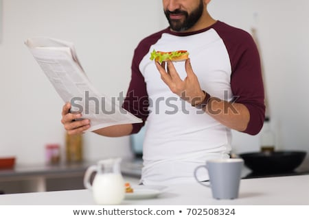 Stockfoto: Man · lezing · krant · home · gelukkig