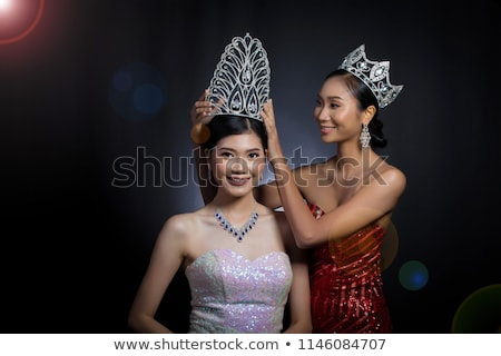 Girl putting on tiara Stock photo © IS2