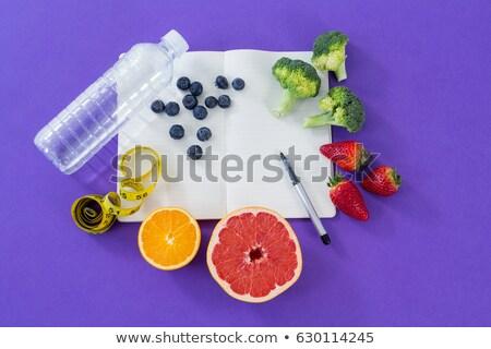 Cinta métrica frutas vegetales libro Foto stock © wavebreak_media