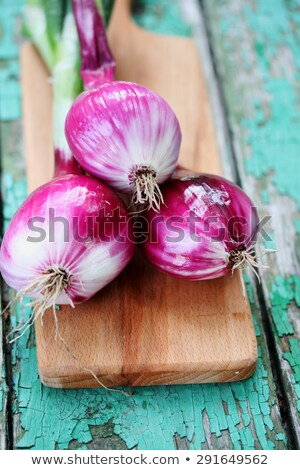 Red onion bulbs on white table Stock photo © dash