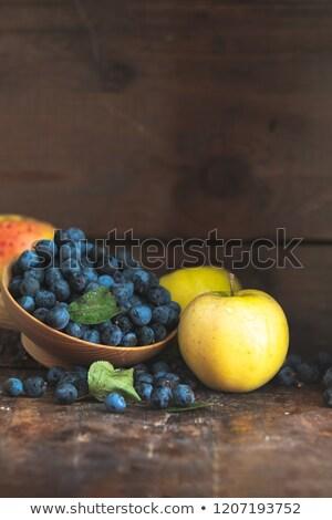 ősz aratás kék bogyók almák fa asztal Stock fotó © artsvitlyna