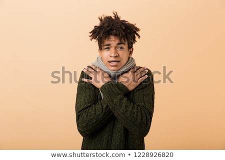 Portrait of frozen african american guy wearing sweater and scar Stock photo © deandrobot