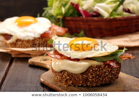 Breakfast  fried Eggs with buns and cheese  Stock photo © zoryanchik