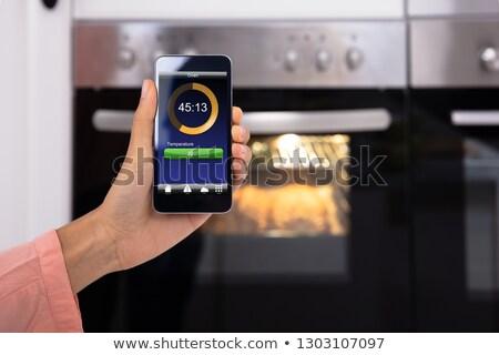 человек · печи · прибор · мобильного · телефона · рук - Сток-фото © andreypopov