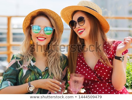 Stock photo: Portrait of two girls wearing sunglasses, happy friends on infla