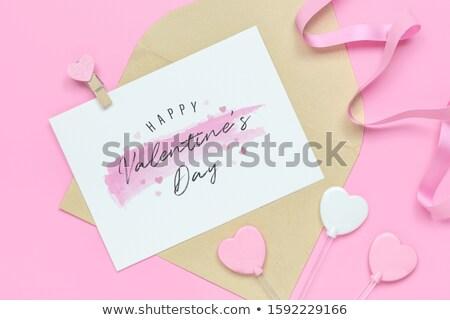 Blank craft envelope, mock-up on a pastel background. Stock photo © artjazz