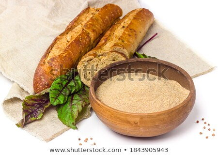 Buckwheat grains in white ceramic bowl on sackcloth background Stock photo © Melnyk