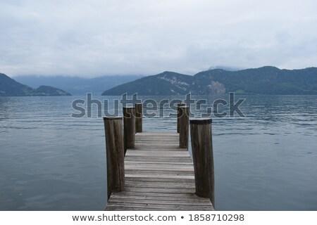 Lucerne lake pier evening view Stock photo © xbrchx