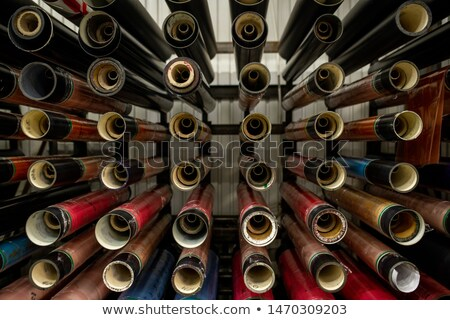 Equipment for newly made polyetylene film to roll on hanging on bars Stock photo © pressmaster