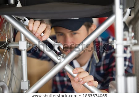 Disabled man repairing chair in workshop Stock photo © Elnur