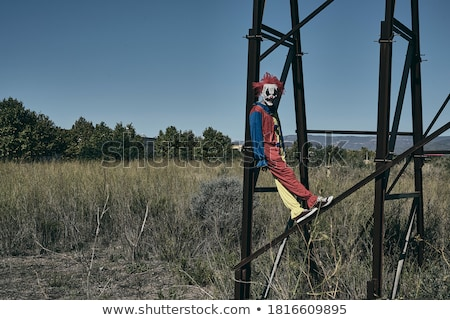 scary clown on an abandoned billboard