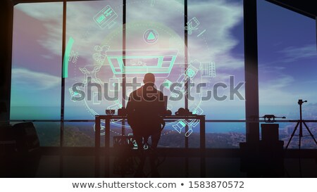 Videographer in studio working with a virtual interface. Stock photo © ConceptCafe
