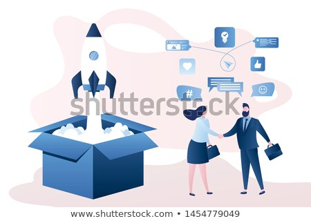 Happy female employee works on developing new project in office, searches information on websites vi Stock photo © vkstudio