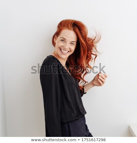 Laughing vivacious woman turning to the camera Stock photo © Giulio_Fornasar