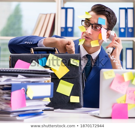 Businessman with reminder notes in multitasking concept Stock photo © Elnur