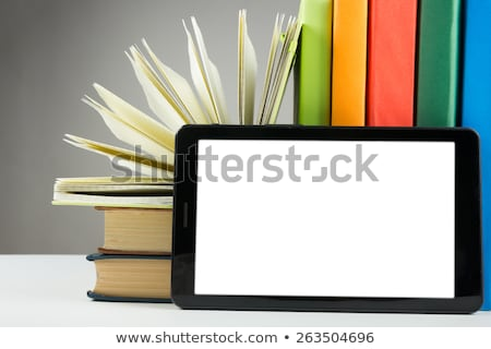 Stack of books and electronic book reader on the white background Stock photo © AndreyKr