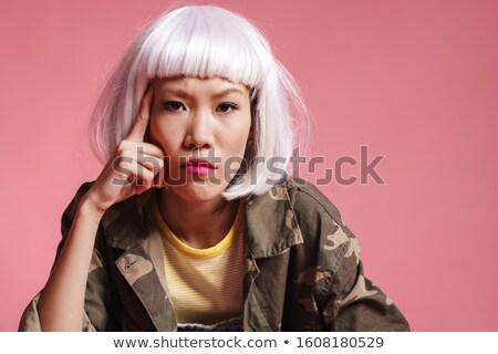 Image of asian girl wearing white wig thinking and looking at ca Stock photo © deandrobot