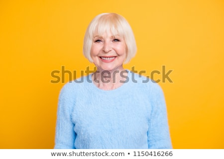 Blond beauty woman on colorful background Stock photo © konradbak