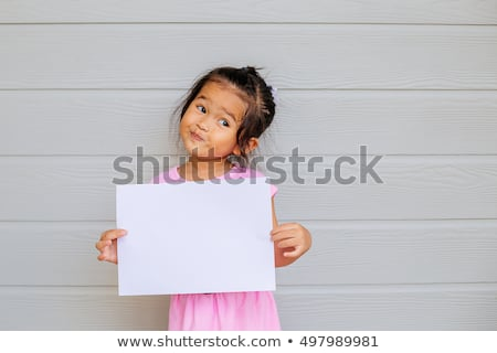 Foto stock: Young Child Holding Sign