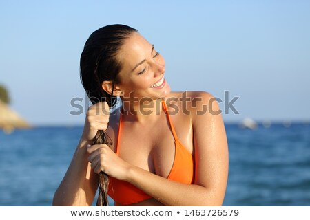 Happy bather woman outdoors with wet hair stock photo © pekour
