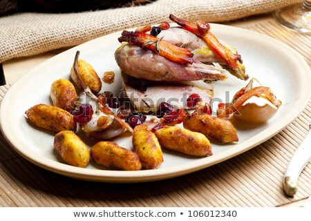 baked pheasant with bacon, pear, raisins on brandy Stock photo © phbcz