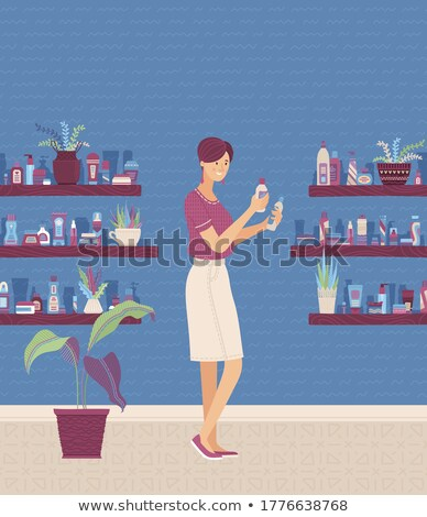 Woman deciding which beauty products to pack Stock photo © photography33