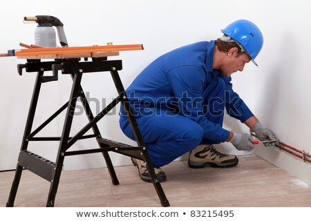 Laborer with screwdriver and blowtorch Stock photo © photography33