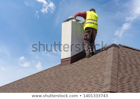 Roofers installing chimney Stock photo © photography33