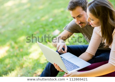 couple with laptop outdoors stock photo © photography33