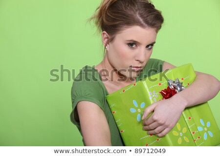 Greedy woman hugging her present all to herself Stock photo © photography33