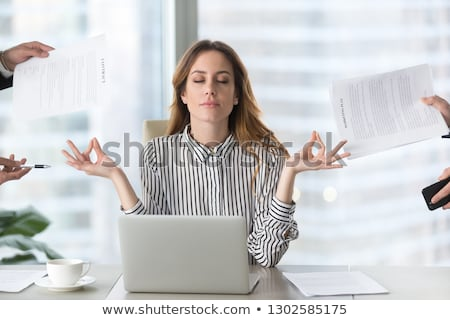 Young businesswoman meditating to relieve stress Stock photo © photography33