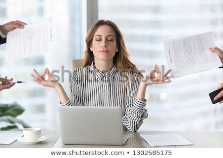 mujer · de · negocios · meditando · piso · pared · gráficos · diagramas - foto stock © photography33
