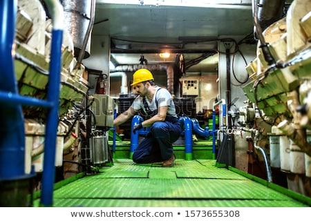 Stock photo: worker with blue helmet kneeling