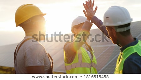 Man with sign and energy panel Stock photo © photography33