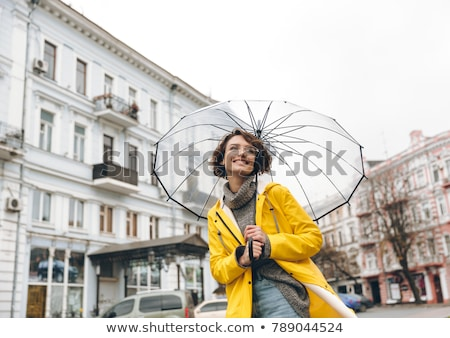 Beautiful brown-haired woman with umbrella Stock photo © photography33