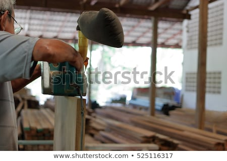 craftsman holding a wooden board and a rasp stock photo © photography33