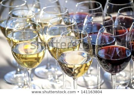 şarap bardakları oturma raf şarap cam gözlük Stok fotoğraf © ca2hill