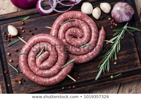 Raw Sausage on Cutting Board Stock photo © cr8tivguy