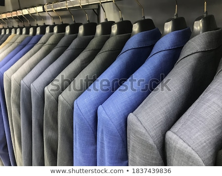 colorful male suits in row in a hanger stock photo © lunamarina