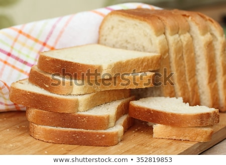 A loaf of fresh bread on a white stock photo © ozaiachin