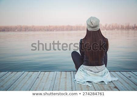 Heureux femme séance bord de l'eau eau Photo stock © photography33
