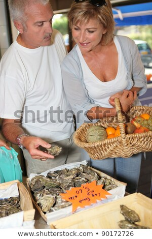 Couple buying oysters Stock photo © photography33