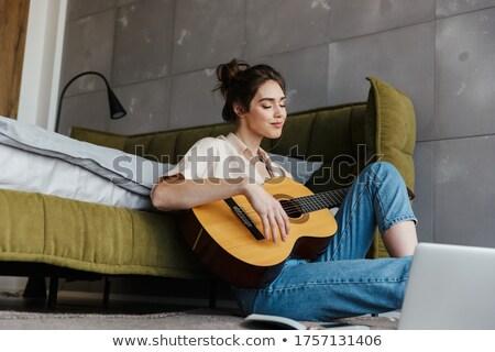 zenész · zene · fiatal · ül · kanapé · gitár - stock fotó © photography33