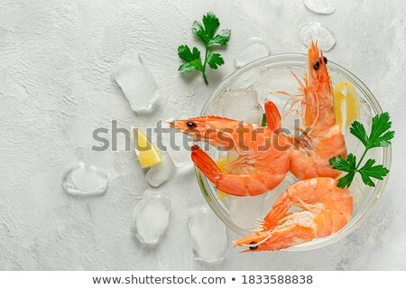 A bowl of fresh raw shrimps cooled with the ice Stock photo © moses