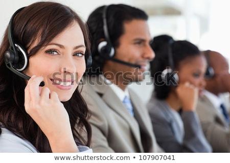 улыбаясь работник работу гарнитура глядя камеры Сток-фото © wavebreak_media