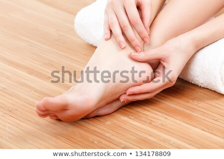 female feet and hands with a white rolled towel stock photo © nobilior