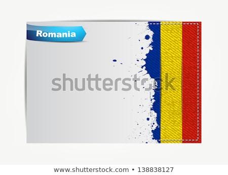 Stitched Romania flag with grunge paper frame stock photo © maxmitzu