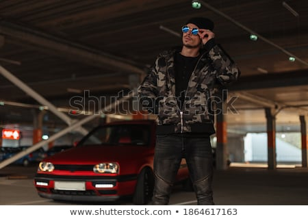 Handsome man with casual clothes posing near his car, outdoors p Stock photo © Victoria_Andreas