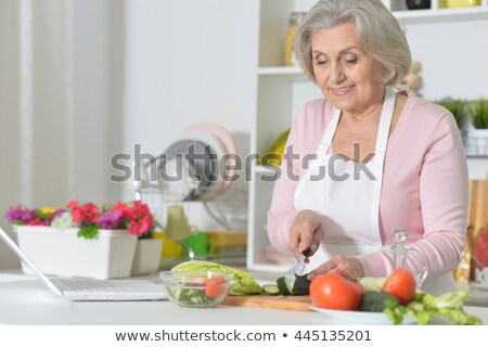 Kıdemli kadın gıda beyaz Stok fotoğraf © doupix